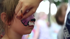 The artist paints face painting - stock footage