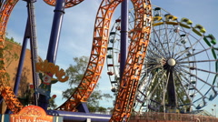 Ferris wheel and other rides in the amusement Park. Time Lapse. Stock Footage