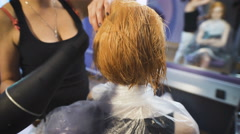 In the professional salon hairstyle on the girl's head dried hairdryer Stock Footage