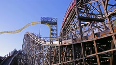 Wooden roller coaster in the amusement Park. Time Lapse. Arkistovideo