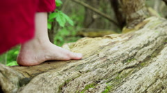 Bare feet of girl walking around in forest 4k Stock Footage