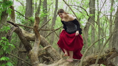 Renaissance girl sneaking around woods 4k Stock Footage