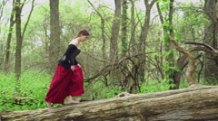 Sneaky renaissance girl walking through woods 4k Stock Footage