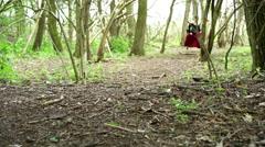 Renaissance era female running through woods 4k Stock Footage