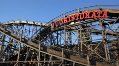 Wooden roller coaster in the amusement Park. Arkistovideo
