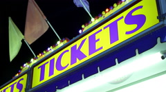 Tickets sign displayed at carnival during night time 4k Stock Footage