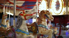 Merry go round horses at carnival ride during evening 4k Stock Footage