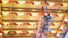 Prizes hanging at carnival game with flashing lights 4k - stock footage