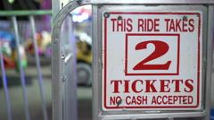 Two tickets to ride sign at carnival attraction 4k Stock Footage