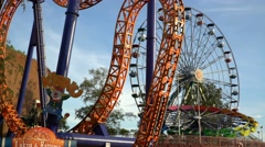 Ferris wheel and other rides in the amusement Park Linnanmaki in Finland. Stock Footage