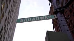 Broadway city street sign in downtown area 4k Stock Footage