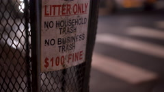 Litter only sign posted on trash bin in city at night 4k Stock Footage