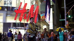 H & M store in downtown Times Square New York Stock Footage