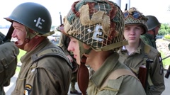 WWII re-enactors awaiting D Day invasion Stock Footage
