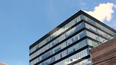 Corporate building Blue and crossing clouds - stock footage