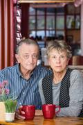 Serious Mature Couple in Coffee House - stock photo