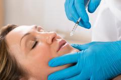Mature Woman Receiving Cosmetic Injection With Syringe In Beauty Clinic Kuvituskuvat