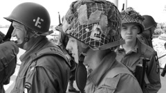 WWII re-enactors awaiting D Day invasion (black & white) Stock Footage