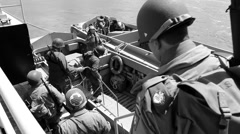 WW II re-enators boarding a higgins boat Stock Footage