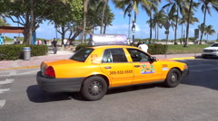 Yellow Taxi Cab on Ocean Drive in Miami Beach Slow Motion - stock footage