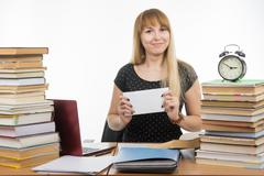 She has prepared an envelope with a bribe teachers for successfully completin - stock photo