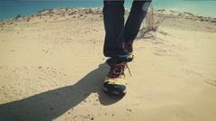 Man Walking on a Sahara Desert Dune close up Stock Footage