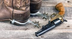 Cowboy pistol and boots. Stock Photos