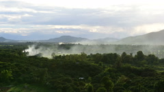 Smoke from a village near the hill. Stock Footage