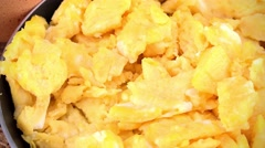 Portion of Scrambled Eggs (not loopable; 4K) - stock footage