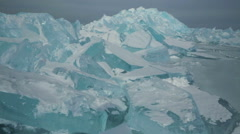 Clumps of blue ice on the snow Stock Footage