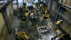 Robots welded the car body 4K loop timelapse Stock Footage
