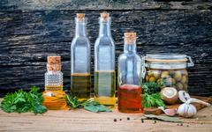 Different sorts of cooking oil,olive oil flavored and Sesame oil with spices Stock Photos