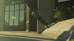 "Skater ""wallies"" off a post - stock footage"