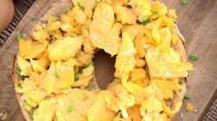 Rotating Scrambled Eggs (not loopable; 4K) - stock footage