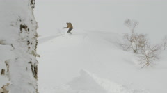 Male Snowboarder Does a Jump, Crashes and Flips in the Powder Snow Stock Footage