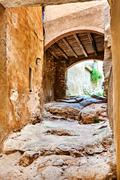 Archway in old town of Miravet, Spain - stock photo