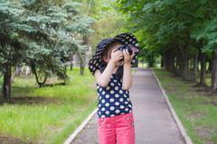 Girl photographer . To look in a lens Stock Photos