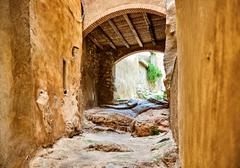 Archway in old town of Miravet Spain - stock photo