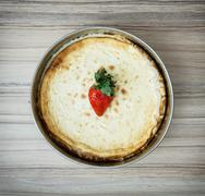 Preparing delicious cheesecake with strawberry, sweet food Stock Photos