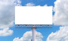 Blank billboard ready for new advertisement with blue sky background Kuvituskuvat