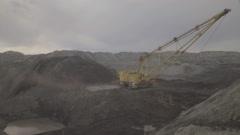 A dragline excavator working on development of open fields Stock Footage