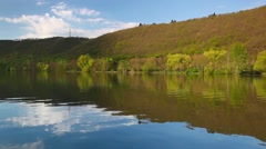 Evening reflection on the Vltava river in Czech Republic - stock footage