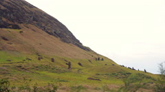 Hillside on the Easter Island, with Moai statues all over Stock Footage