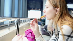 Attractive woman sucking sweets on wooden stick. Stock Footage