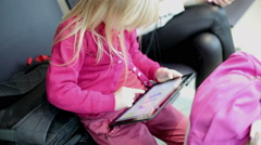 Small girl playing games on a tablet computer. Stock Footage