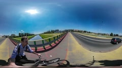 360Vr Video Man Riding a Bicycle Taking Himself With Camera on a Stick Cyclist Stock Footage
