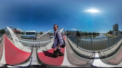 360Vr Video Backpacker is Walking by Bridge Red Bicycle Lane Cars Are Driven by Stock Footage