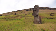 Moai statue standing proudly down the hill Stock Footage