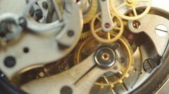 Metal cogwheels inside clockwork.  Tick-Tick Sound Stock Footage