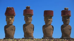 Moai statues under the clear blue sky Stock Footage